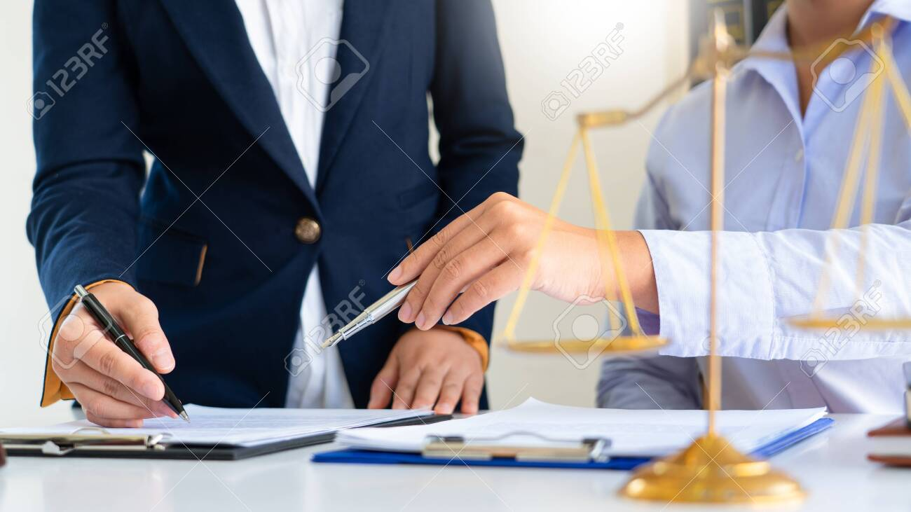 Female Lawyer explaining legal situation and discussing with contract papers, Concepts of law, justice and legal services. - 140450630