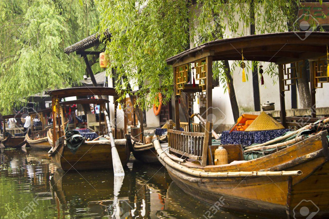 Gondolas in Zhouzhuang, China are an attraction for tourists as well as a way to get around the town for the locals. Stock Photo - 13691590