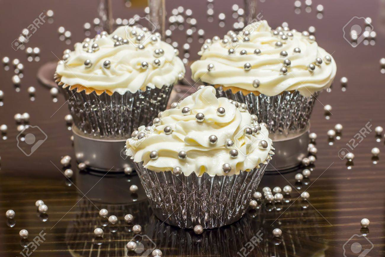 White cupcake with silver decorations Stock Photo - 14271460
