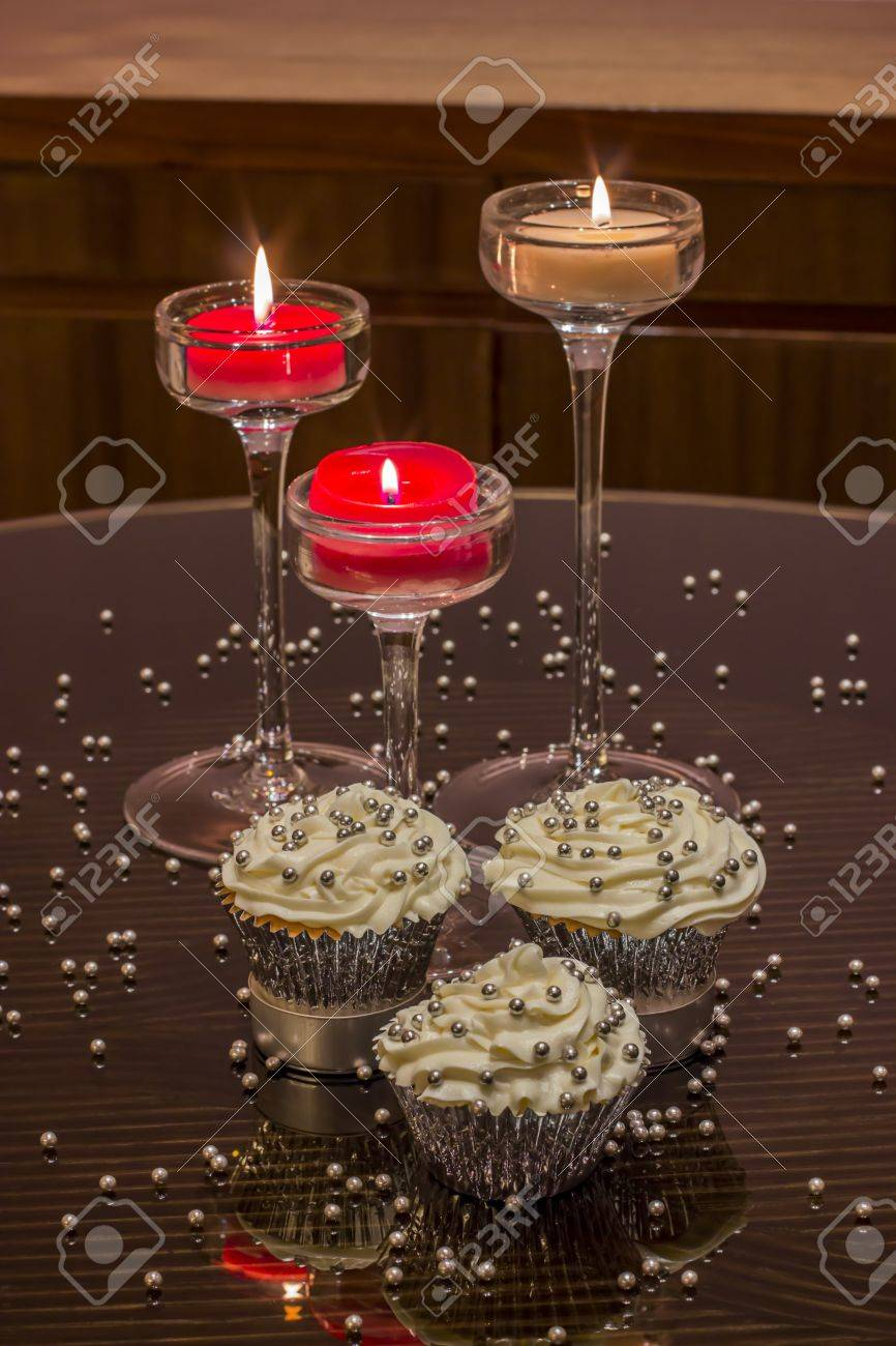 White cupcake with silver decorations Stock Photo - 14271461