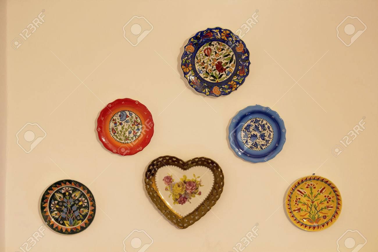 Decorative Ceramic Plates On Beige Wall. Traditional Turkish.. Stock ...