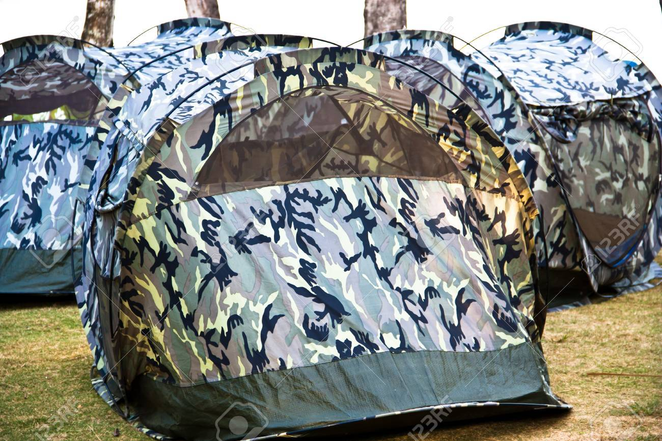 A small canvas tent military pattern is placed on the lawn at