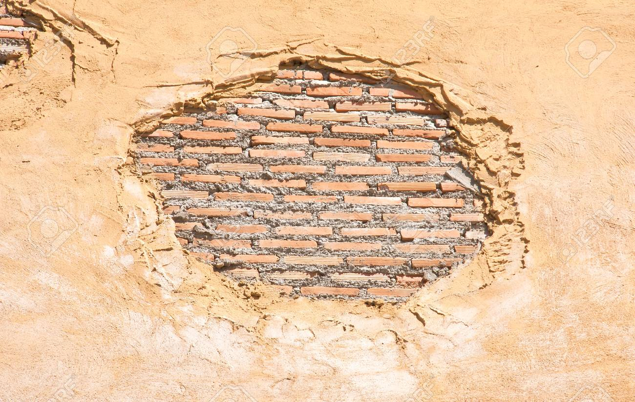 Brick wall with an old plaster as a background Stock Photo - 17448051