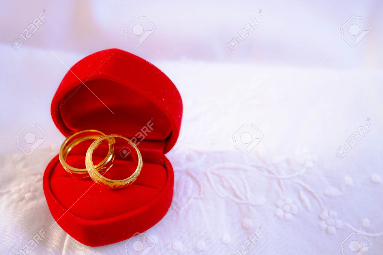 Wedding Rings On Red Box Whith White Cloth Background Stock Photo