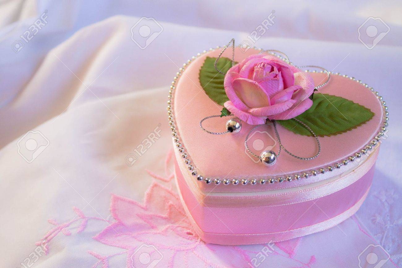 Wedding heart-shaped box with rose petals Stock Photo - 15214213