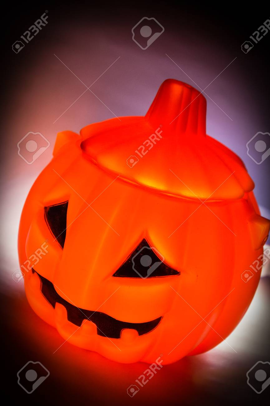 Halloween pumpkin with scary face with reflection on black Stock Photo - 22795900