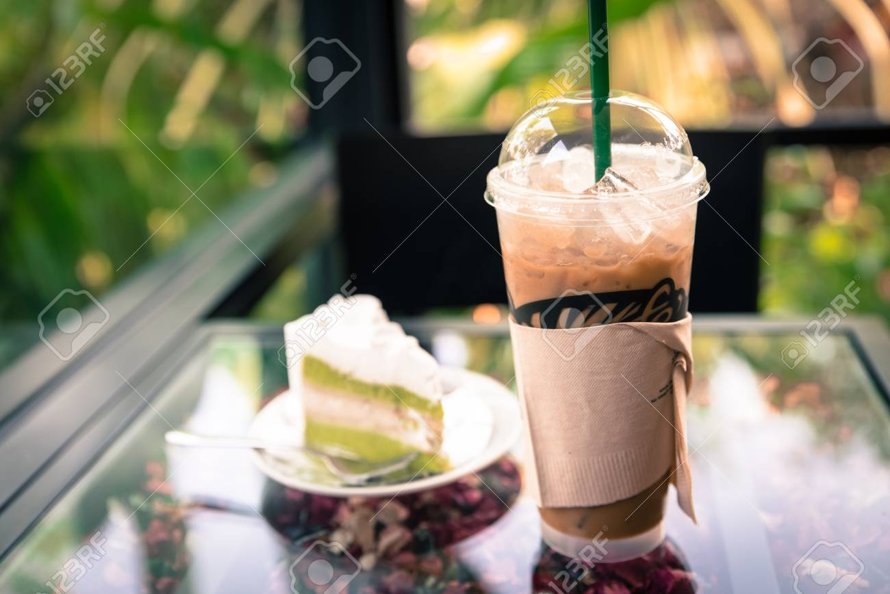 Iced Coffee With Coconut Cheese Cake On The Table In Cafe Coffee Stock Photo Picture And Royalty Free Image Image 78248954