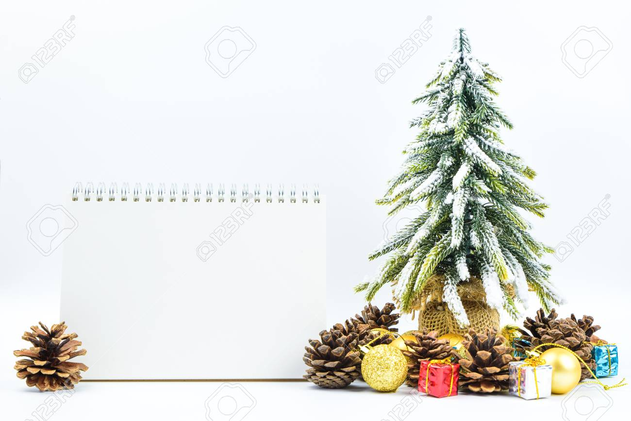 christmas or new year background with blank note padpine conesgift box