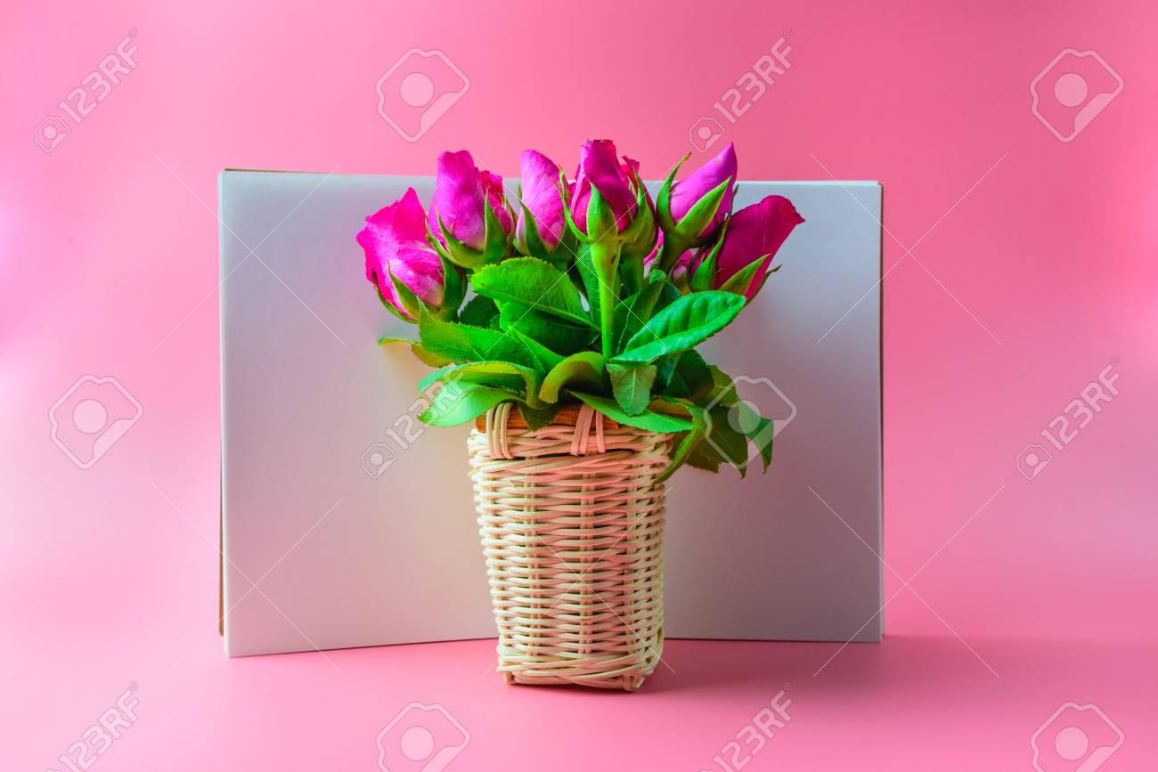 Basket Of Pink Roses Decorative With Blank Notepad On Top View ...