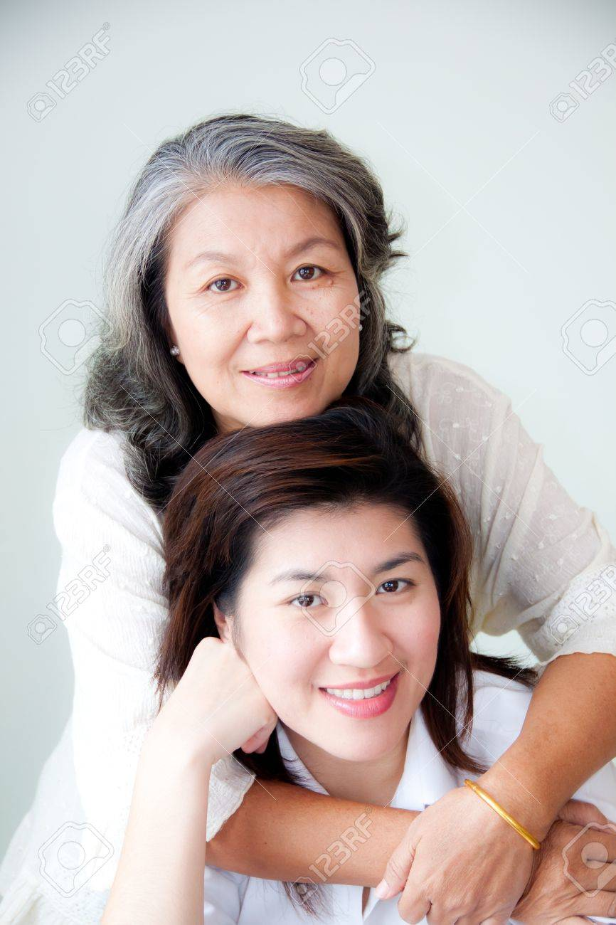 two asian women enbracing Stock Photo - 10600195