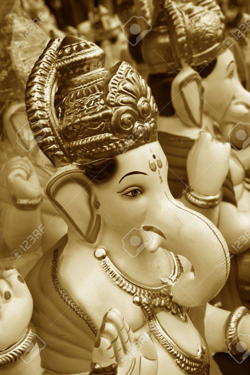 An artistic background of beautiful Ganesha idols for sale in an Indian festival, in a golden tone. Stock Photo - 4722955