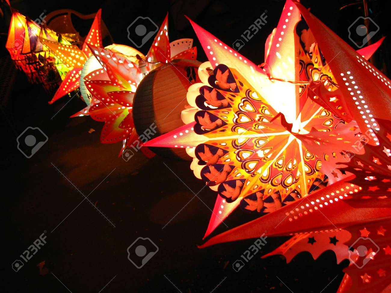 A backgorund with a view of a line of beautifully designed colorful lanterns (also locally called as skylanters) decoration, lit of the occasion of Diwali / Christmas festival in India. Stock Photo - 4722947