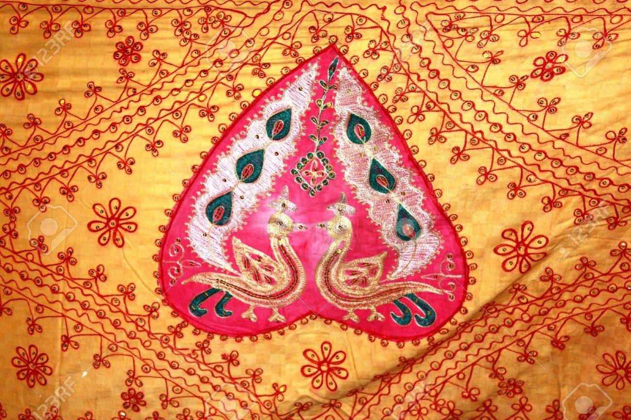 A background with a view of traditional Indian artwork on a Hindu ritual fabric. Stock Photo - 5455434
