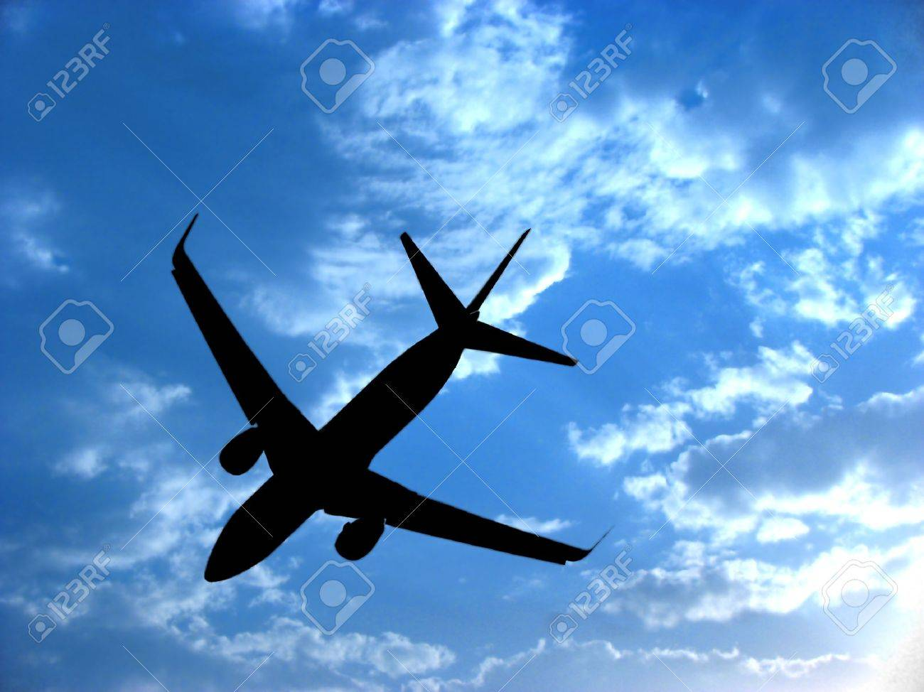 a background with a view of an airplane silhouette against the