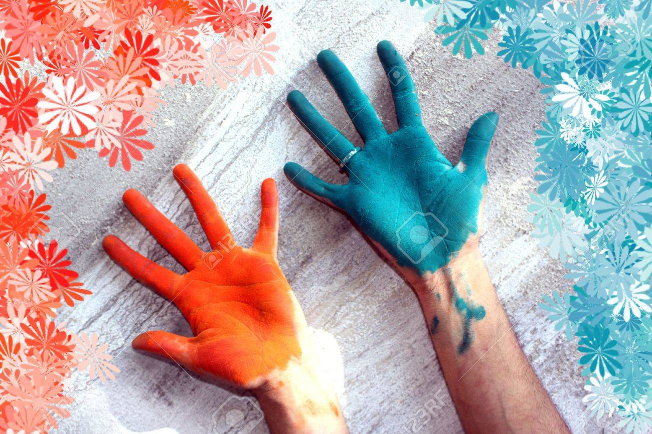 Hands colored with Holi festival colors, with a floral pattern around. Stock Photo - 6568792