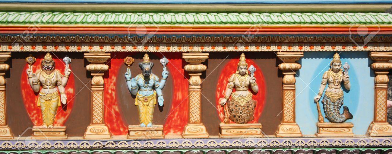 Colorful sculptures depicting avatars of hindu god Vishnu on a temple wall in India. Stock Photo - 9513304