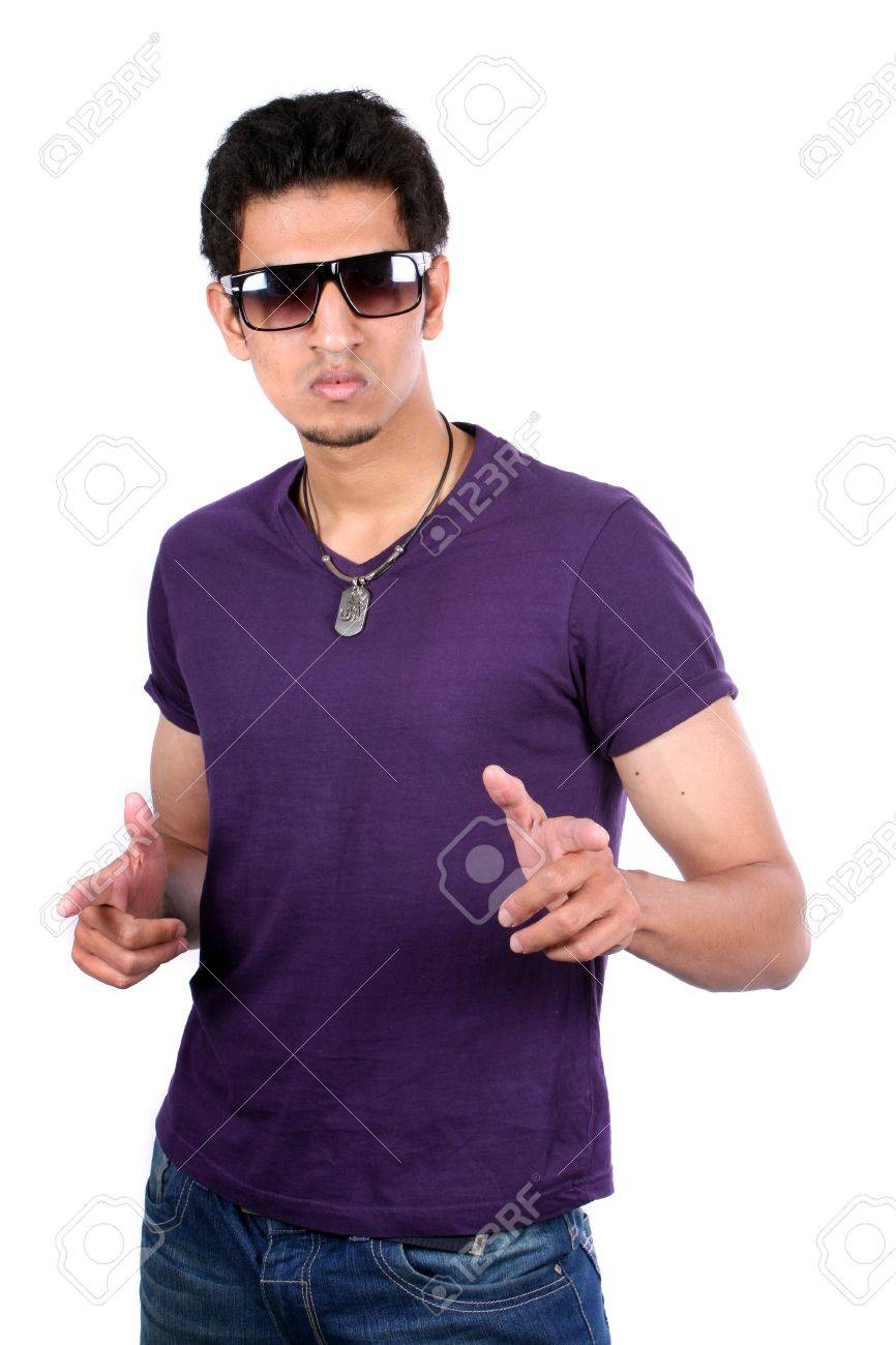 A handsome young Indian guy pointing at you appearing to choosing you, on white studio background. Stock Photo - 11793978