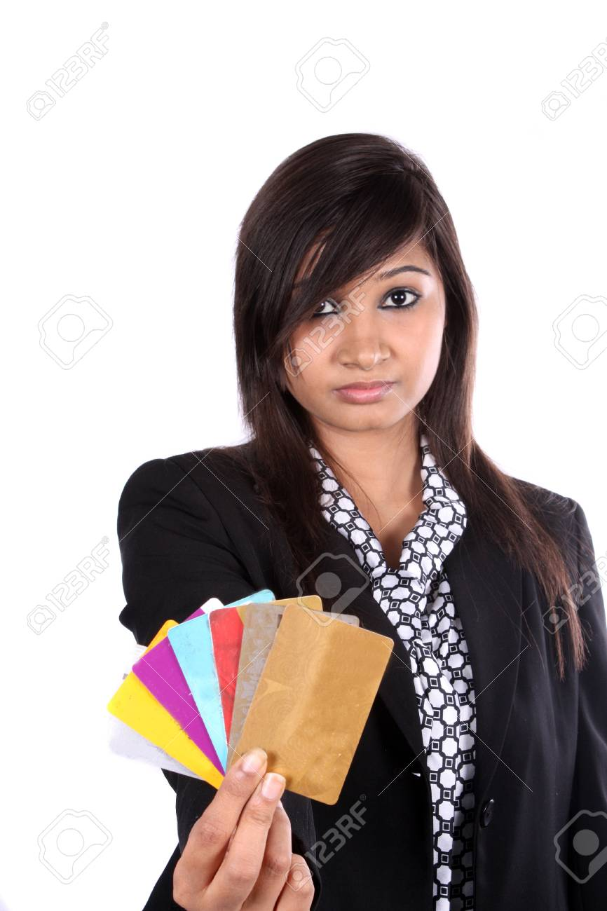 An indian business executive showing different credit cards stock an indian business executive showing different credit cards on white studio background stock photo reheart Images
