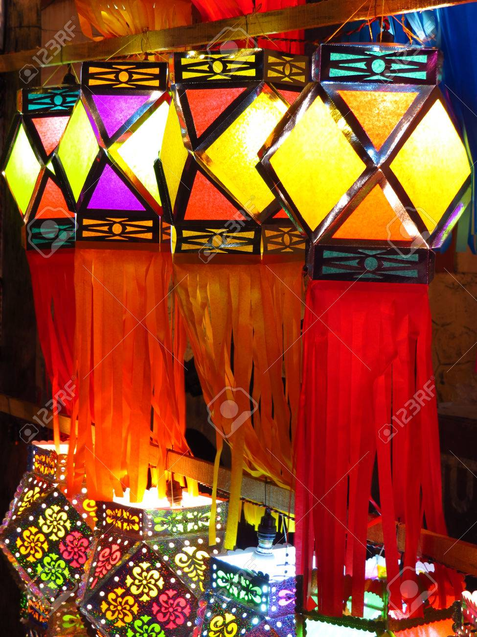 a decorated line of traditional colorful diwali lanterns lit stock