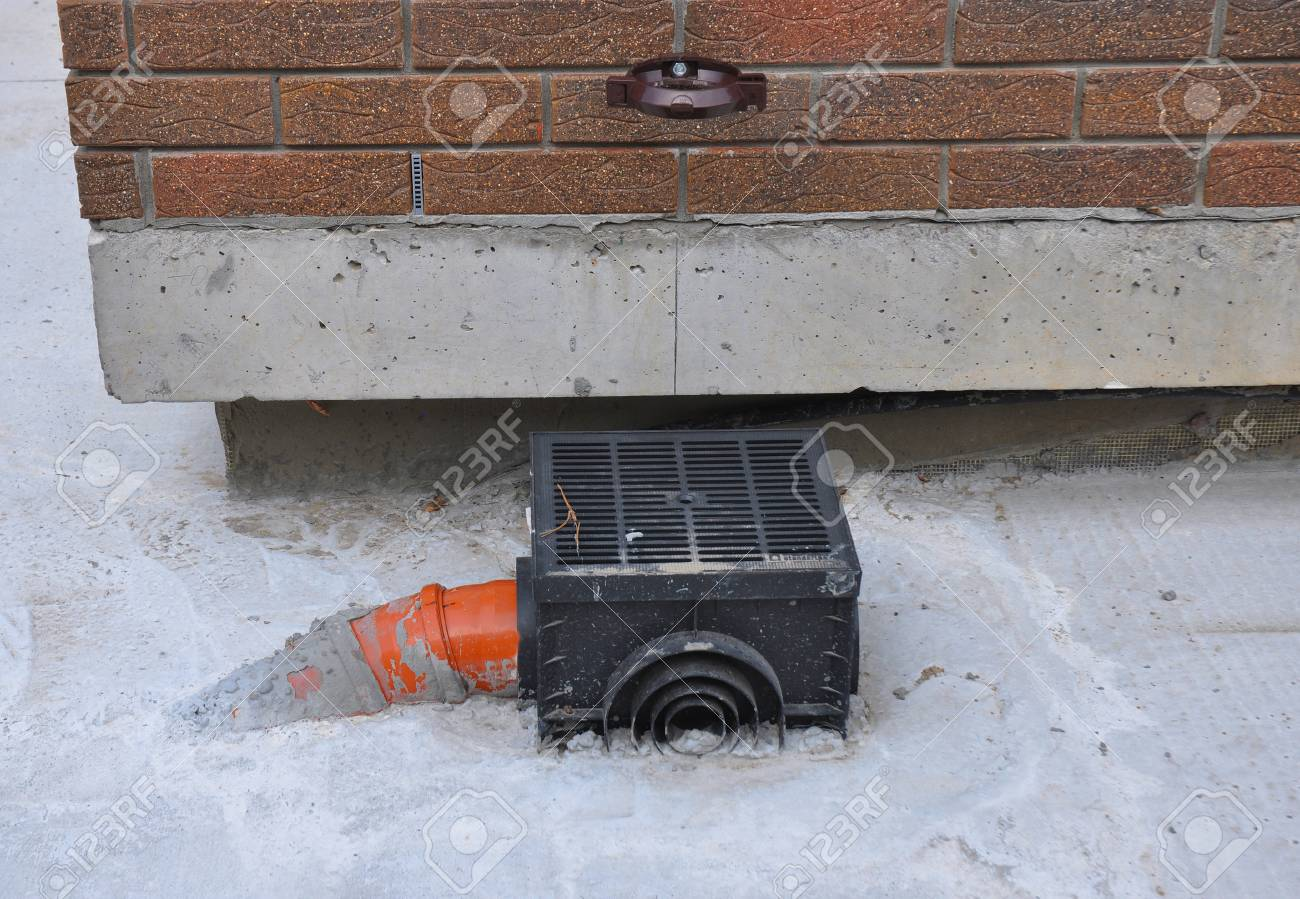 Rain gutter with new installed underground drainage system on