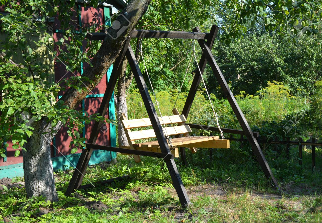 Wooden Garden Swing Garden Swing Seat In Tree Shadow Light Stock