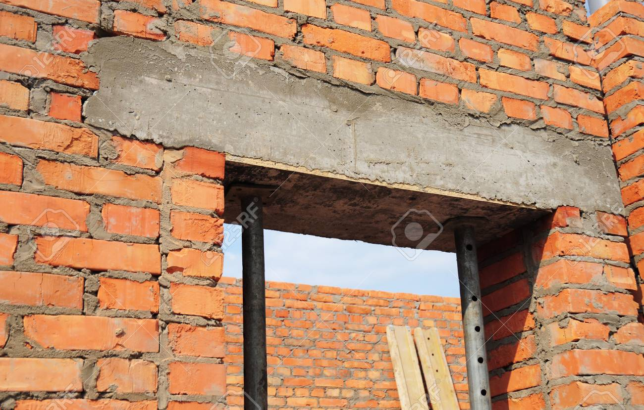 Window door concrete lintel with iron bar on brick unfinished house & Building House Construction. Window Door Concrete Lintel With ...