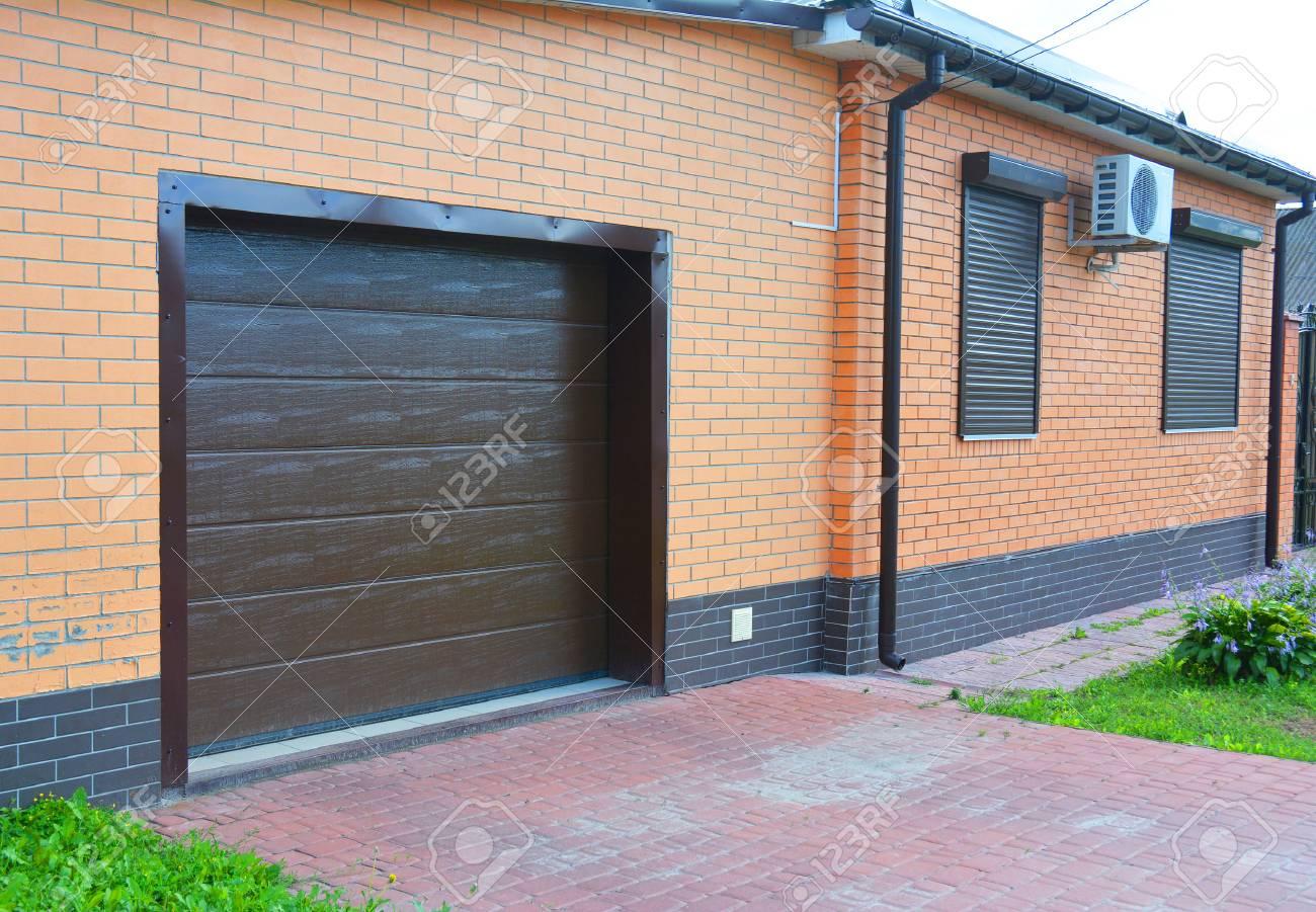 House Garage Door With Ventilation Air Conditioner Rain Gutter