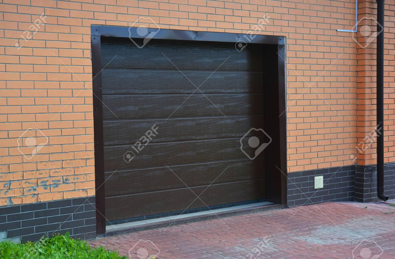 Garage Door Installation Repair With Ventilation System Stock Photo