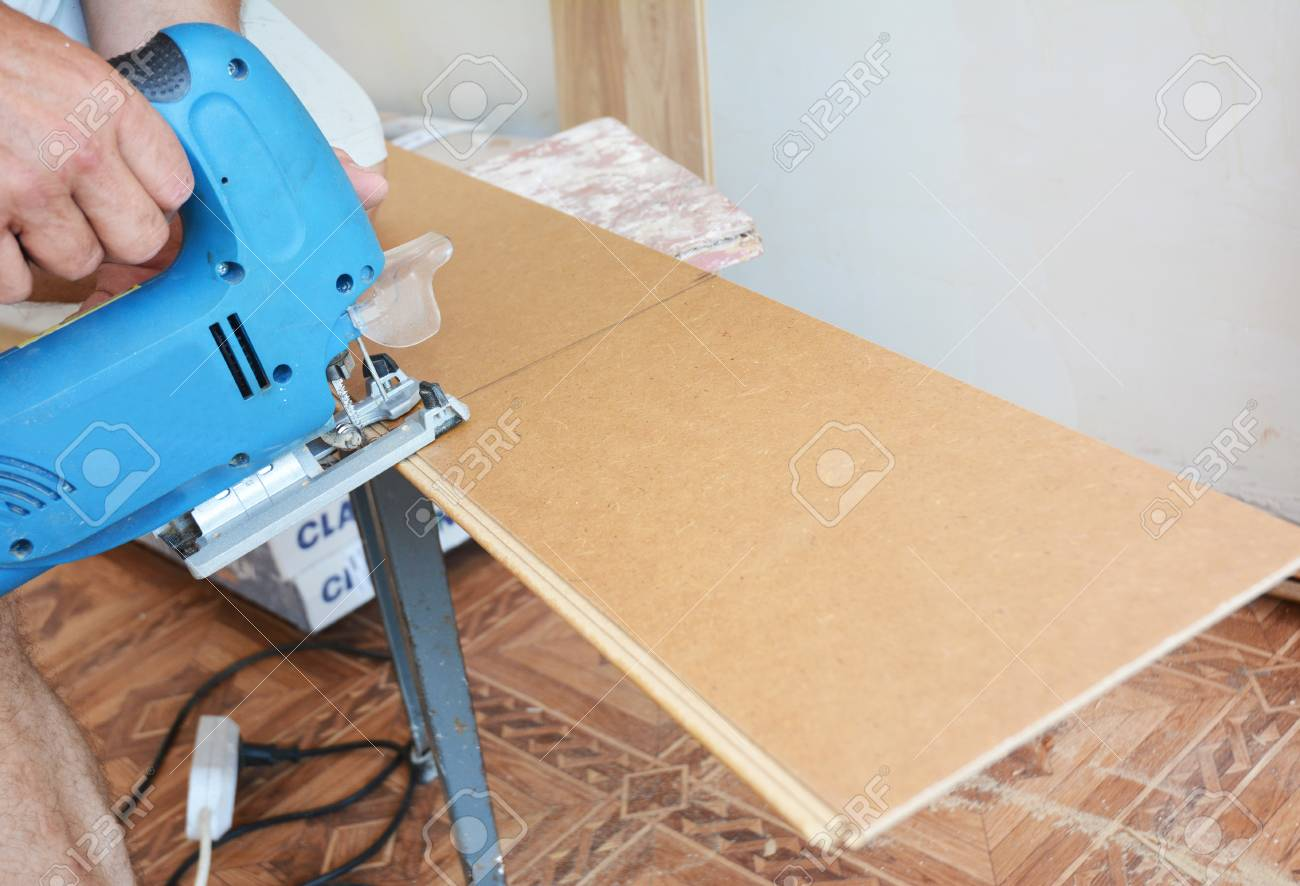Cutting Laminate Flooring Lengthwise With Hand Saw Stock Photo 87735485