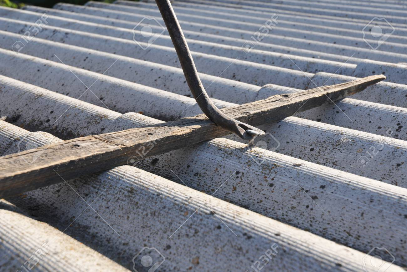 Close up on asbestos removal  Roof repair and asbestos removal