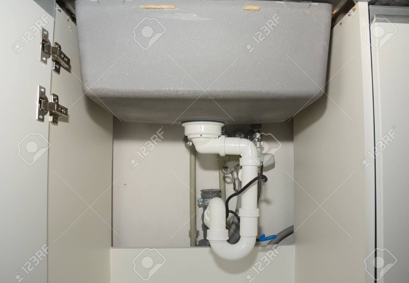 Close Up On Ceramic Kitchen Sink Installation With Sink Drain Stock Photo Picture And Royalty Free Image Image 91317726