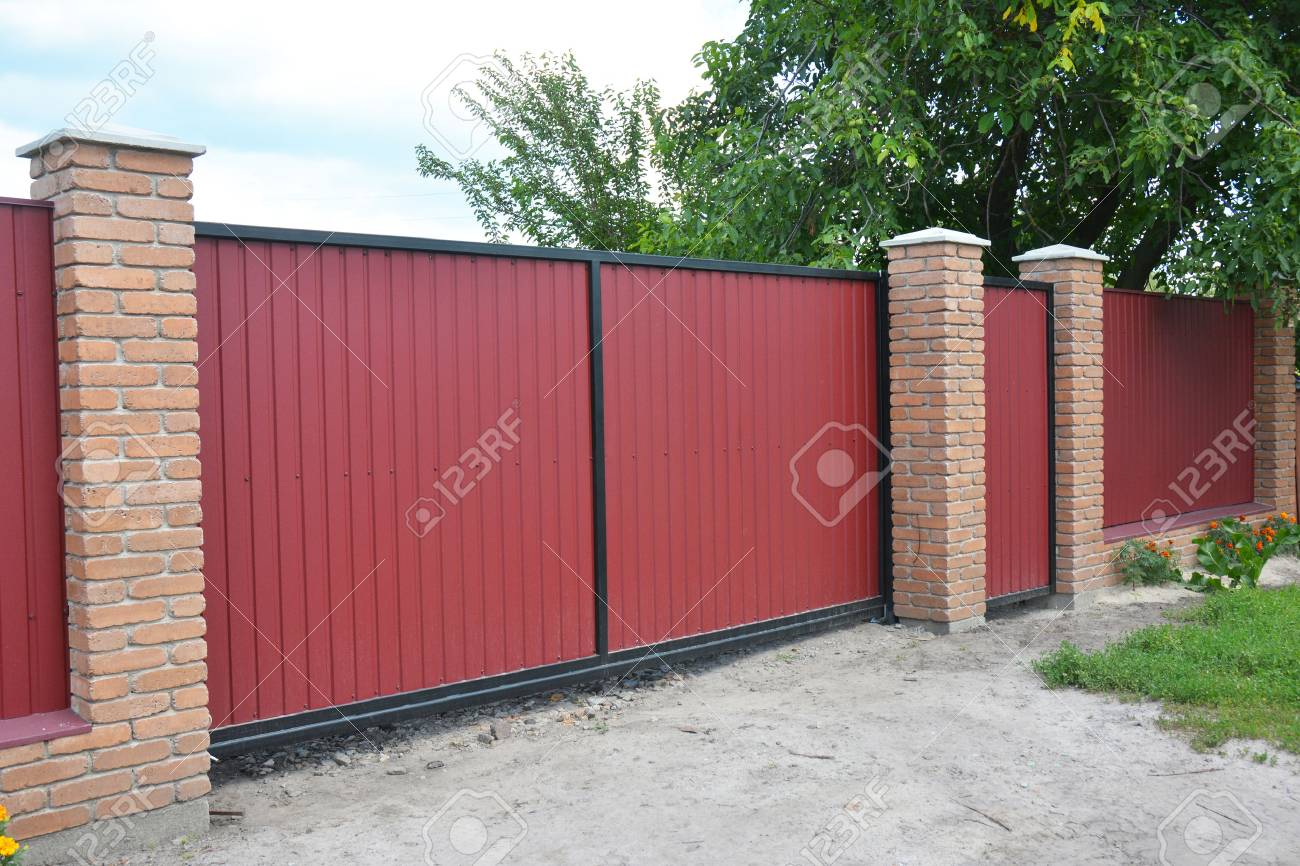 Installing Brick And Metal Fence Gate With Door Red Metal Fencing Stock Photo Picture And Royalty Free Image Image 91307402