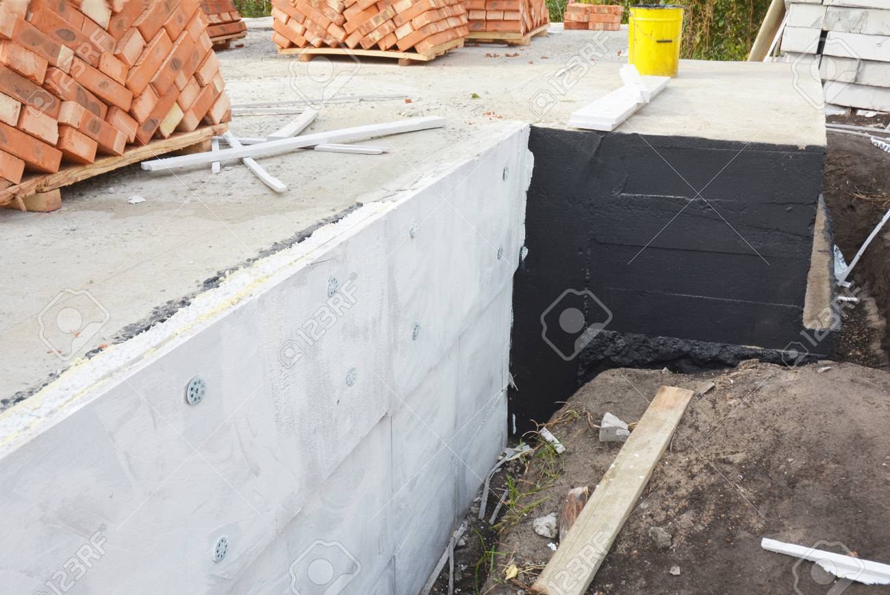 Waterproofing house foundation with bitumen and polystyrene rigid