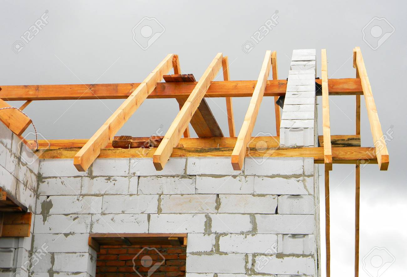 Timber Roof Trusses Building. Wooden Roof Frame House Construction ...