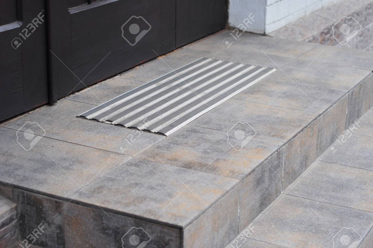 Protect From Ice Cover Slippery Stair Case. How To Avoid Danger Frozen  Steps. Stock