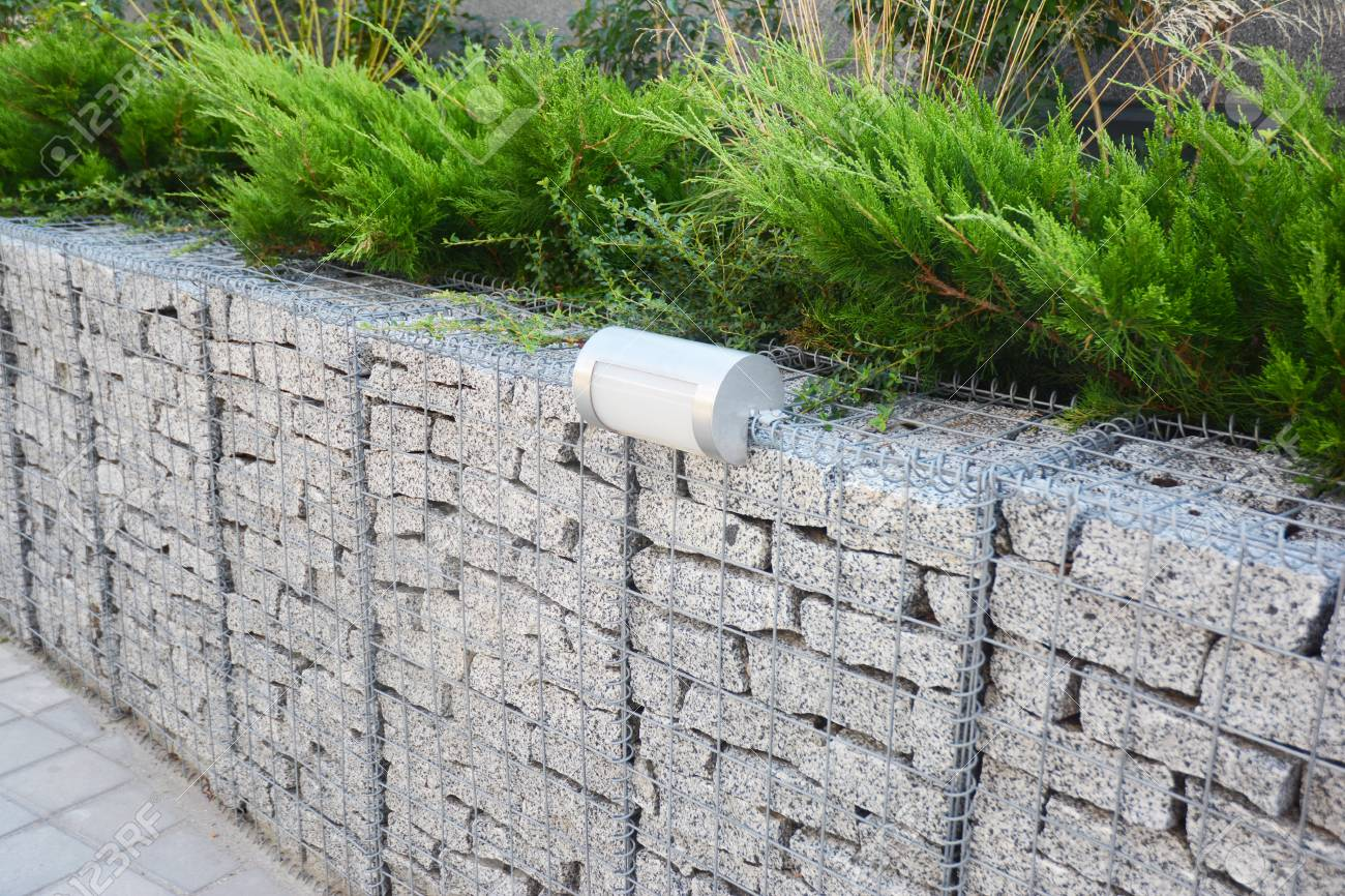 Gabion Fence With Stones In Wire Mesh And Outdoor Lighting. Gabion ...