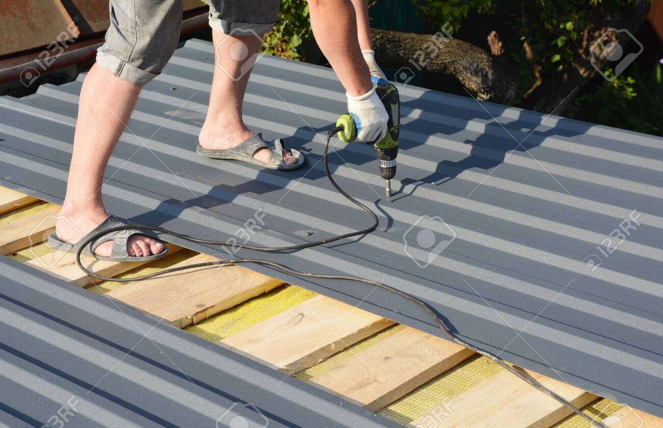 Roofing Construction Roofer With Crew Gun Installing Lightweight