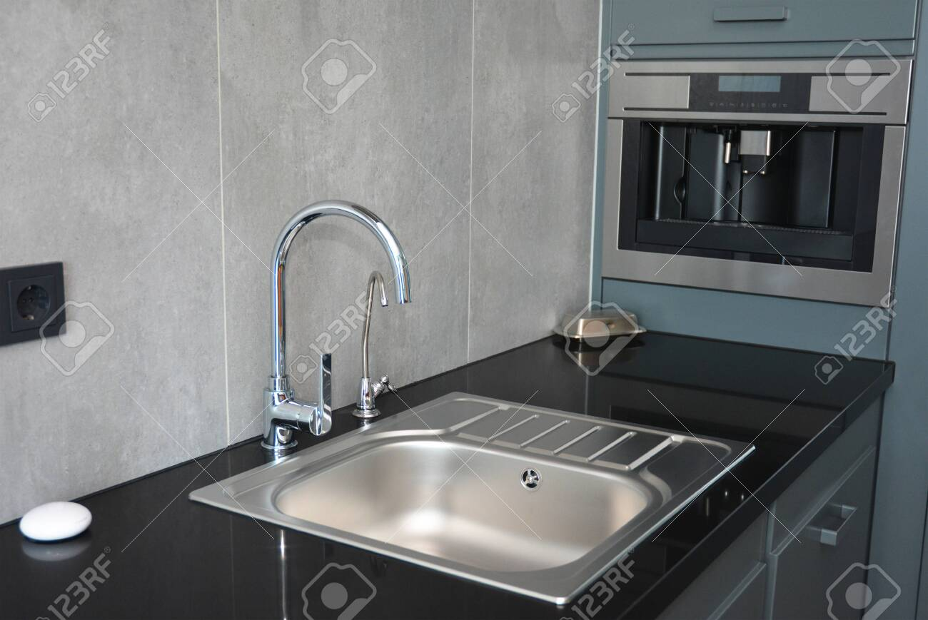 Modern Kitchen With Chrome Faucet Water Tap Black Kitchen Stock Photo Picture And Royalty Free Image Image 134866155