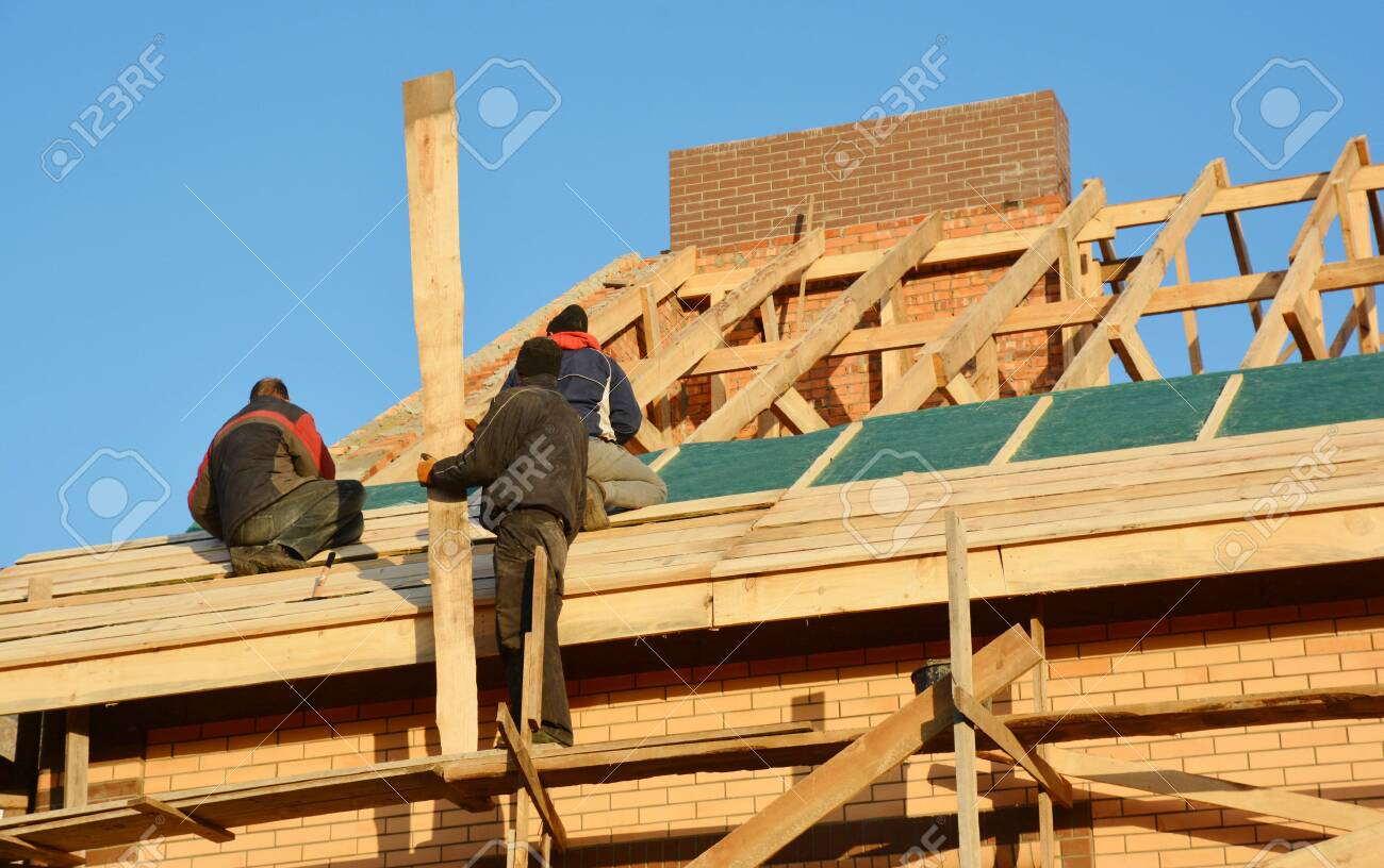 Roofing Contractors Installing House Framework Roof Board For Stock Photo Picture And Royalty Free Image Image 134941264