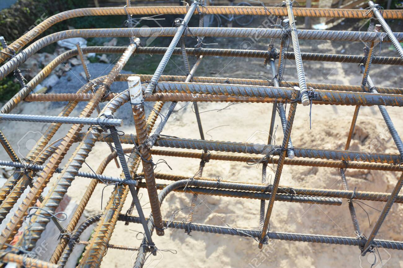 Installation of steel bar reinforcement, footing rebar, welded wire reinforcement in foundation concrete house construction. - 146602718