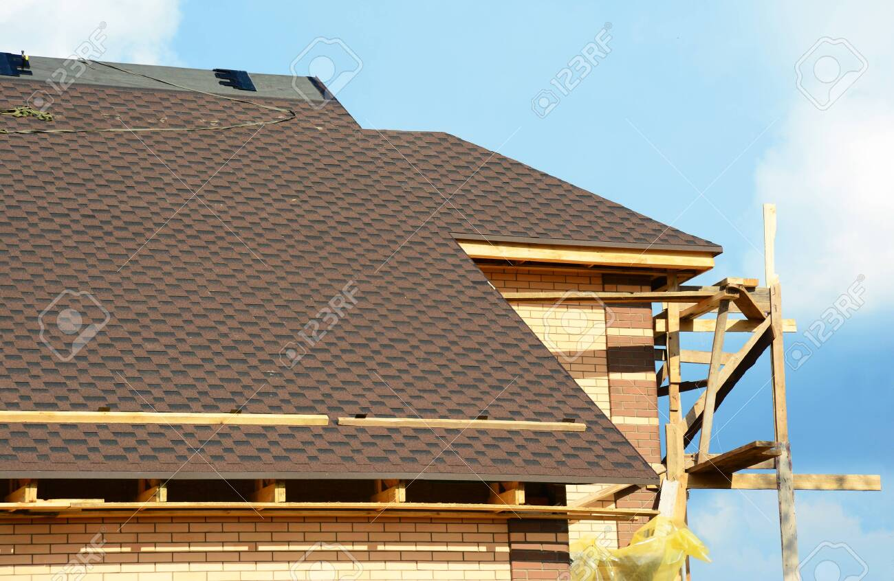 A close-up on unfinished roofing construction, covered with dimensional..