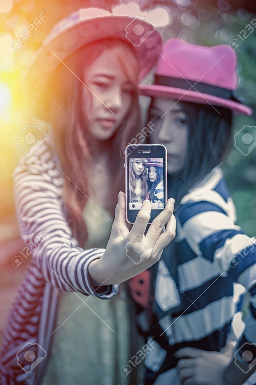 Free self shot pictures Asia Beautiful Girlfriends Taking A Self Shot With Phone Add Stock Photo Picture And Royalty Free Image Image 58085997