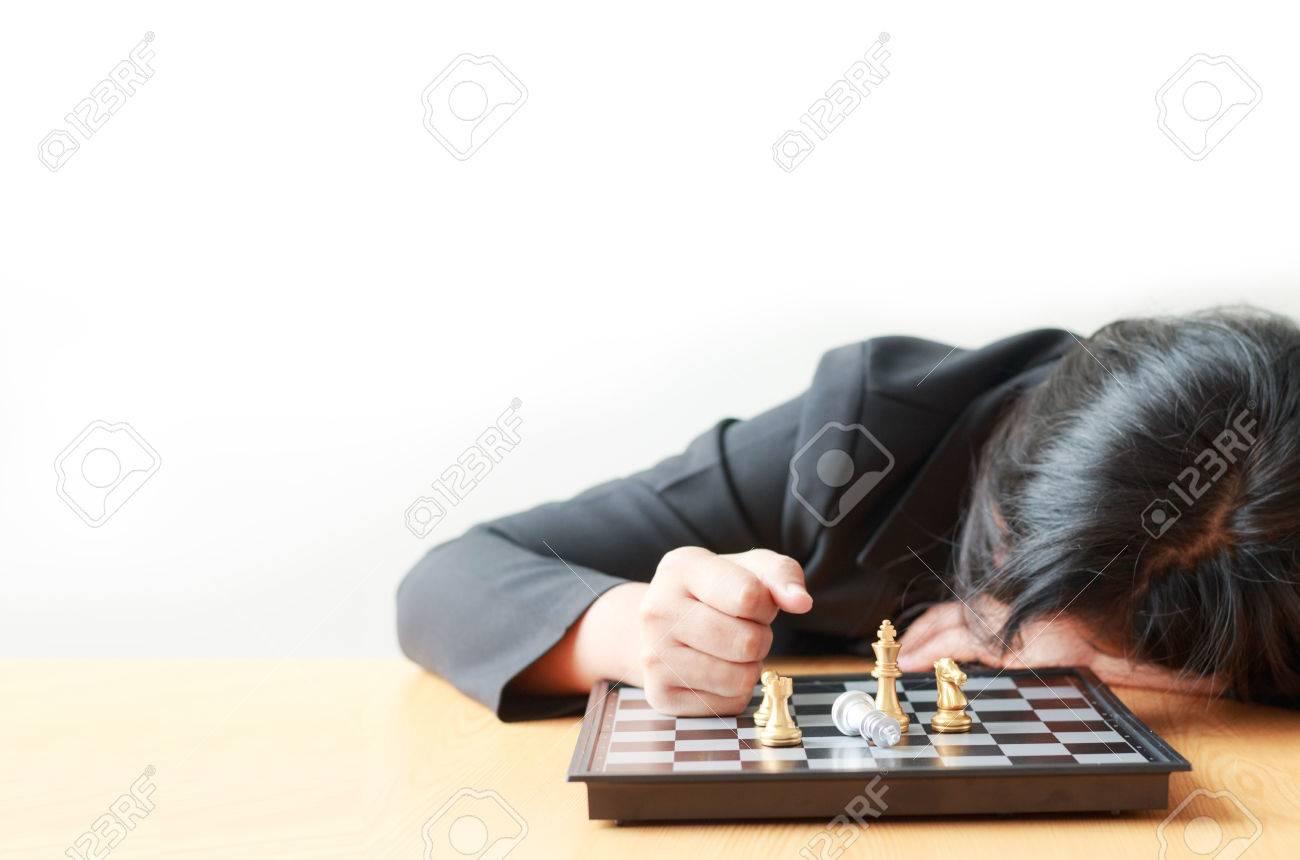 fc77e25a5985 Business woman face down on the table losing in game with chess board for  business challenge