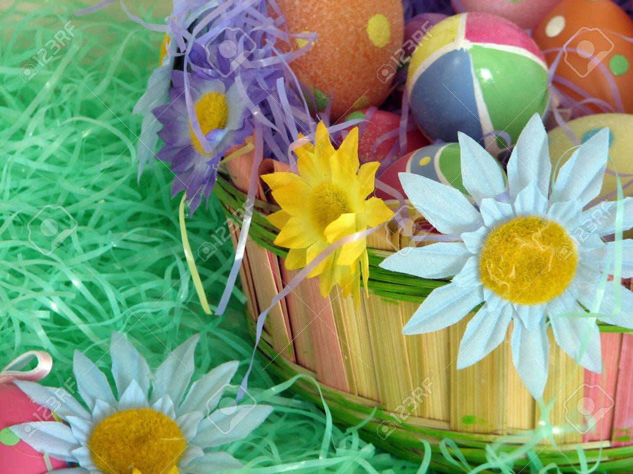 Shot Of A Traditional Decorated Easter Basket With Some Flowers ...