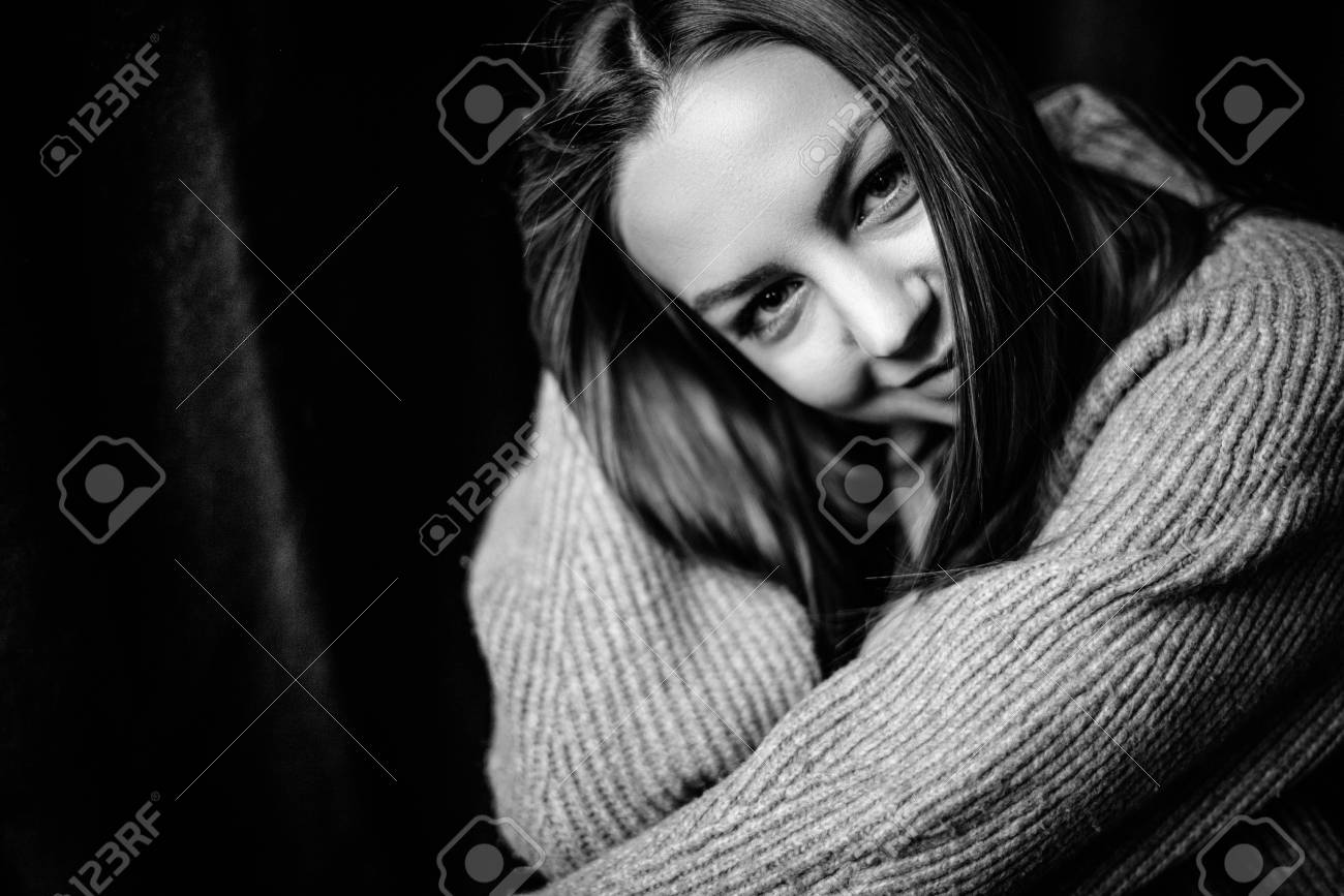 Emotional and atmospheric black and white portrait of a beautiful