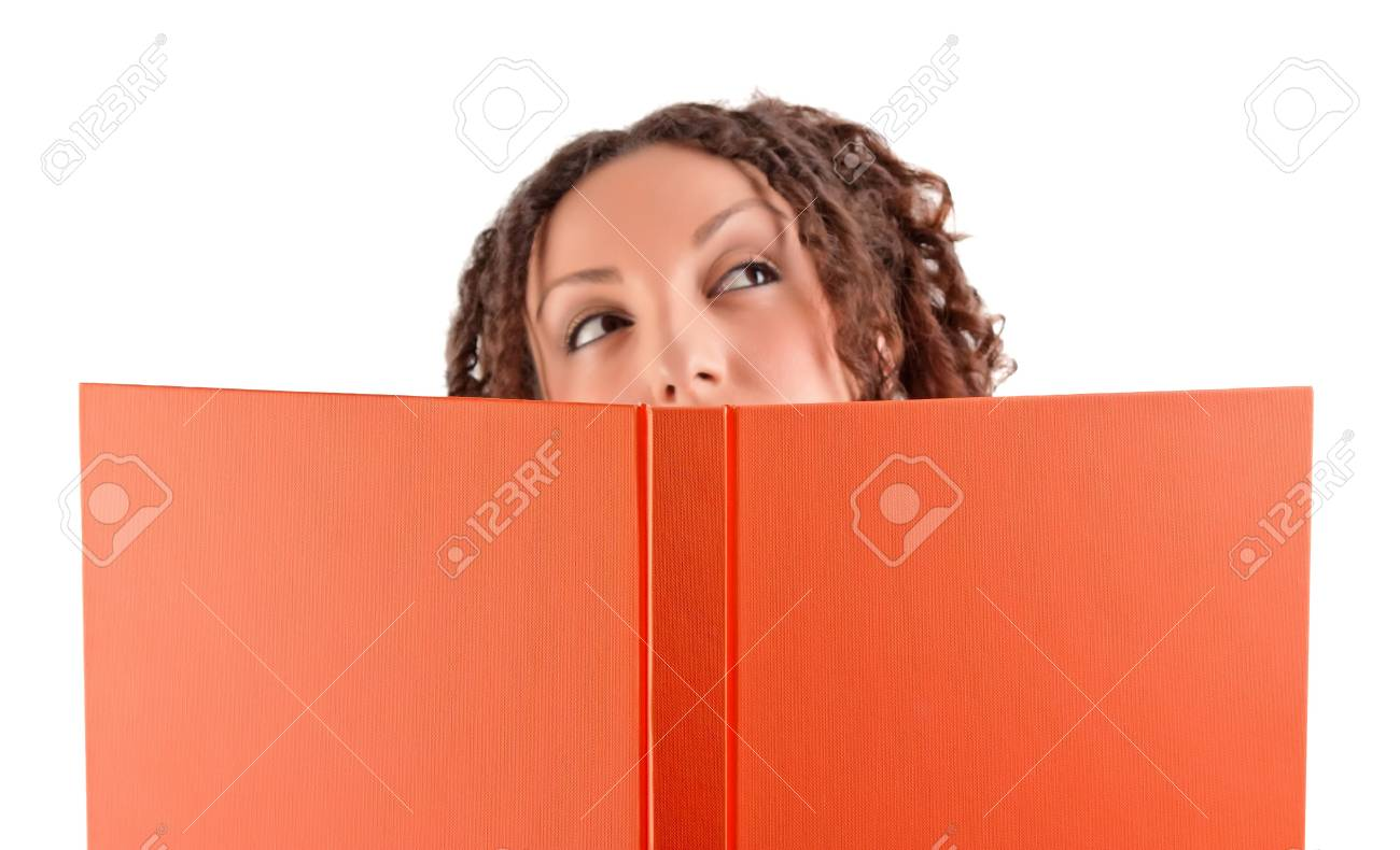 Young student thinking an idea while holding a book. Stock Photo - 7673869