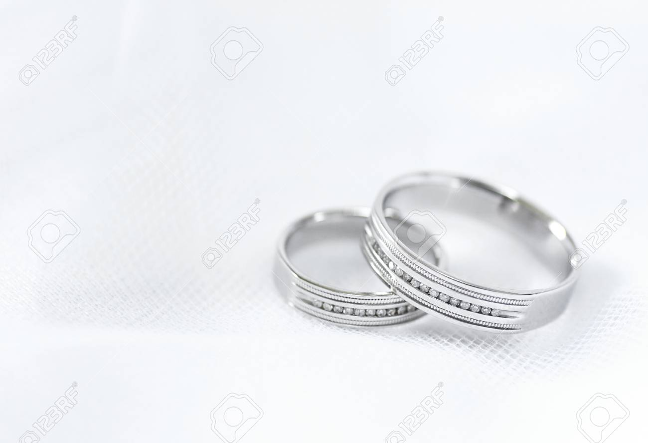 Two Wedding Rings Made Of White Gold On White Background