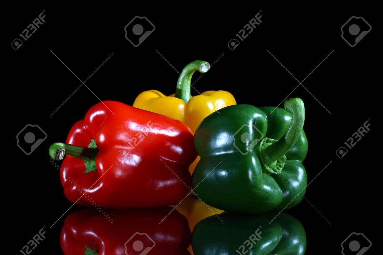 Three bell peppers red, green and yellow on black background with reflection Stock Photo - 16295081