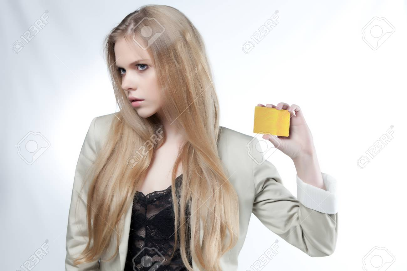 beautiful girl show golden credit card on a white background Stock Photo - 13173090