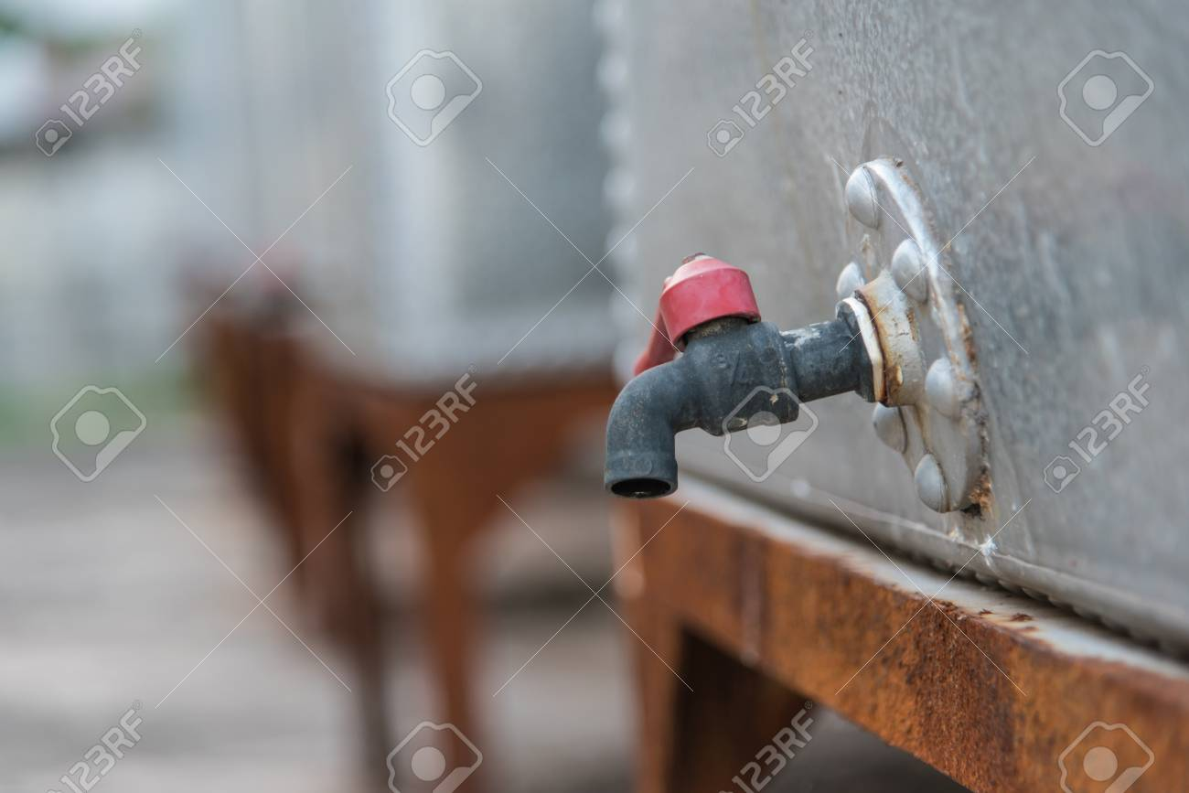 Old Faucet,Old Rusty Water Tap On Cracked Stock Photo, Picture And ...